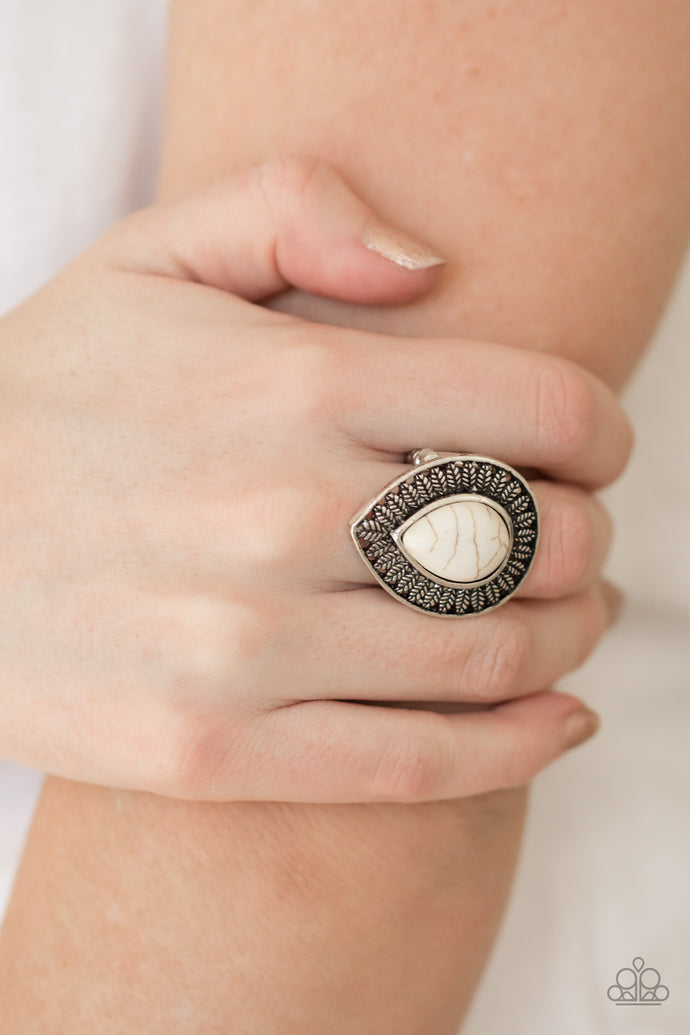 Chiseled into a tranquil teardrop, an earthy white stone is pressed into a silver frame radiating with leafy foliage. Features a stretchy band for a flexible fit.  Sold as one individual ring.  Always nickel and lead free.