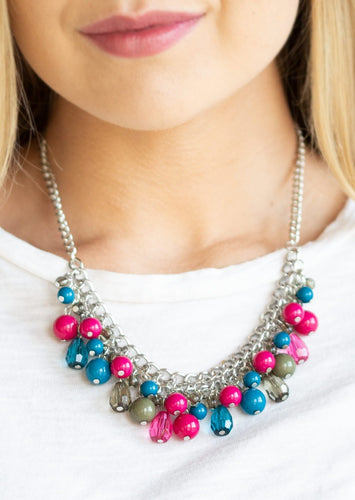 Varying in shape, glassy and polished blue, green, and pink beads swing from the bottom of interlocking silver chains. Crystal-like teardrops are sprinkled along the colorful beading, creating a flirtatious fringe below the collar. Features an adjustable clasp closure.  Sold as one individual necklace. Includes one pair of matching earrings.  Always nickel and lead free.
