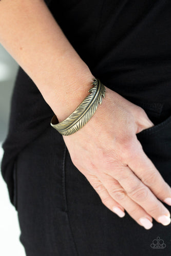 Brushed in an antiqued shimmer, a lifelike brass feather wraps around the wrist, creating a seasonal cuff.  Sold as one individual bracelet.  Always nickel and lead free.