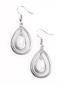 Etched in serrated shimmer, two silver teardrops drip from the ear in a refined fashion.