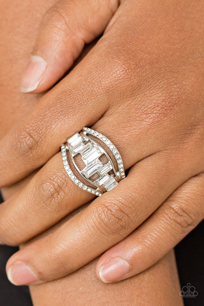 White rhinestone encrusted bands flank a row of emerald cut glass beads in shades of white for a regal look. Features a stretchy band for a flexible fit.  Sold as one individual ring.  Always nickel and lead free.