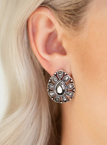 A silver teardrop frame is encrusted in glittery hematite rhinestones, creating a sparkling floral frame. Earring attaches to a standard post fitting.  Sold as one pair of post earrings.  Always nickel and lead free.