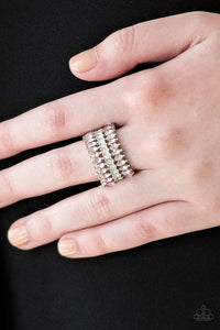 Featuring refined marquise cuts, glittery pink rhinestones flare from a center of glassy white rhinestones, creating a regal band across the finger. Features a stretchy band for a flexible fit.  Sold as one individual ring.  Always nickel and lead free.