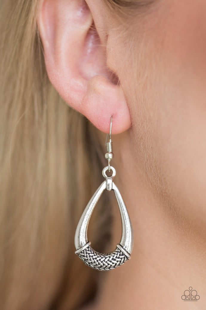 The center of a glistening silver teardrop is embossed in a metallic rope-like pattern for an artisan inspired look. Earring attaches to a standard fishhook fitting.  Sold as one pair of earrings.  Always nickel and lead free.