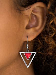 Chiseled into a dainty triangle, a red stone is pressed into the top of a triangular frame for an artisan inspired look. Earring attaches to a standard fishhook fitting.  Sold as one pair of earrings.  Always nickel and lead free..