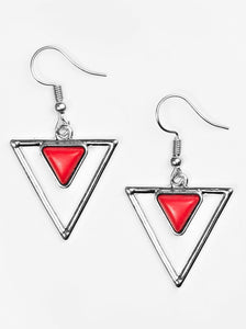 Chiseled into a dainty triangle, a red stone is pressed into the top of a triangular frame