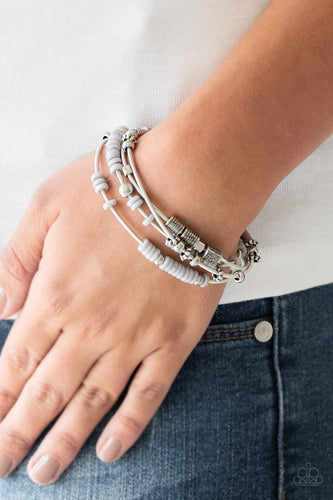 Mismatched silver accents and disc shaped gray beading slides along stretchy spring-like wires for a spunky tribal look.  Sold as one set of four bracelets.  Always nickel and lead free.