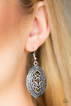 Load image into Gallery viewer, Featuring filigree filled details, a shimmery silver frame swings from the ear for a tribal inspired look. Earring attaches to a standard fishhook fitting.  Sold as one pair of earrings.  Always nickel and lead free.