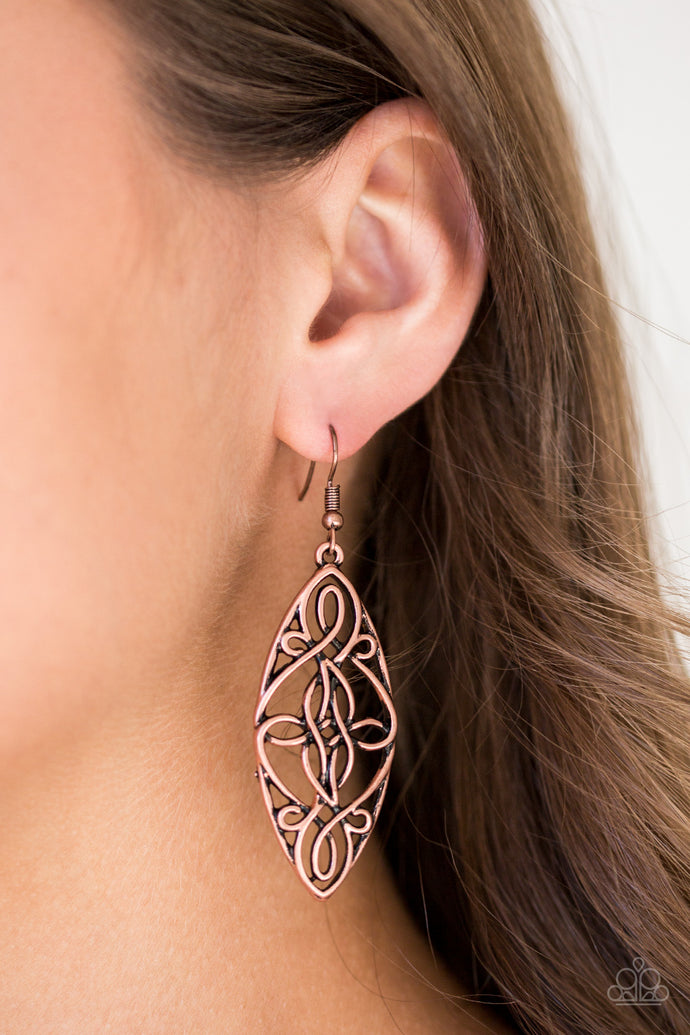 Brushed in an antiqued shimmer, glistening copper wire twists into a decorative frame for a seasonal look. Earring attaches to a standard fishhook fitting.  Sold as one pair of earrings.  Always nickel and lead free.