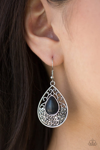 An earthy black stone is pressed into the center of a shimmery silver teardrop radiating with dotted and frilly filigree textures for a seasonal look. Earring attaches to a standard fishhook fitting.  Sold as one pair of earrings.  Always nickel and lead free.