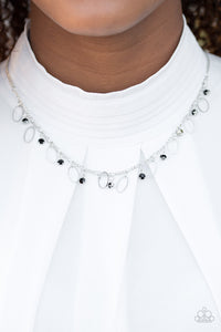 Glittery black rhinestones and dainty silver frames swing from a silver chain, creating a twinkling fringe below the collar. Features an adjustable clasp closure.  Sold as one individual necklace. Includes one pair of matching earrings.  Always nickel and lead free.