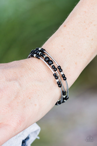 Shiny black beading and shimmery silver accents alternate along a coiled wire to create an earthy infinity wrap style bracelet.  Sold as one individual bracelet.  Always nickel and lead free.