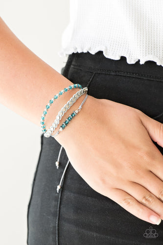 Infused with a strand of faceted blue and classic silver beads, shiny gray cording knots around mismatched beads for an edgy look. Features an adjustable sliding knot closure.  Sold as one individual bracelet.  Always nickel and lead free.