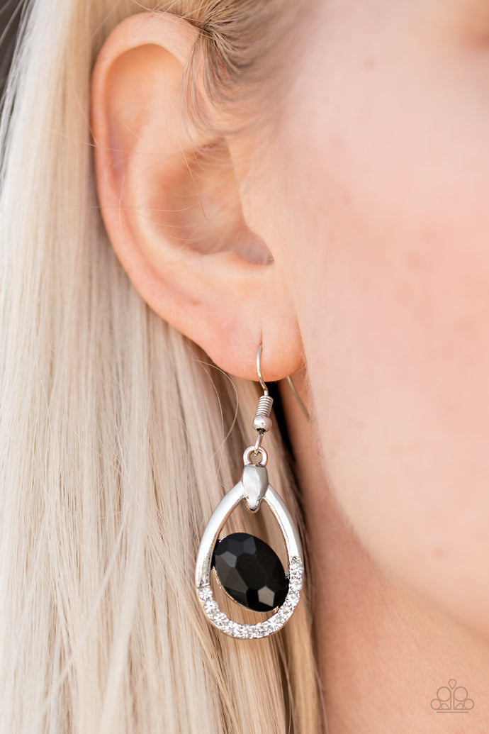 As if dipped in glitter, the bottom of a silver teardrop frame is encrusted in sparkling white rhinestones. A faceted black gem sits off center in the middle of the frame for a regal finish. Earring attaches to a standard fishhook fitting.  Sold as one pair of earrings.  Always nickel and lead free.