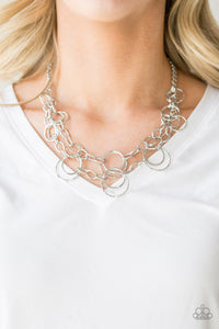 Mismatched silver hoops and rings link into two shimmery rows below the collar for a bold industrial look. Features an adjustable clasp closure.  Sold as one individual necklace. Includes one pair of matching earrings.  Always nickel and lead free.