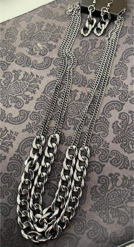 A double layer of large gunmetal chain create an edgy look.  Sold as one individual necklace. Includes one pair of matching earrings.  Always nickel and lead free.  Fashion Fix Exclusive March 2021