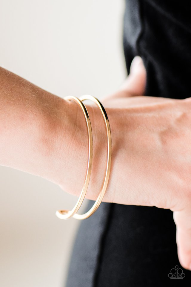 Brushed in a glistening finish, shiny gold bars arc across the wrist, joining into a sleek cuff.  Sold as one individual bracelet.  Always nickel and lead free.