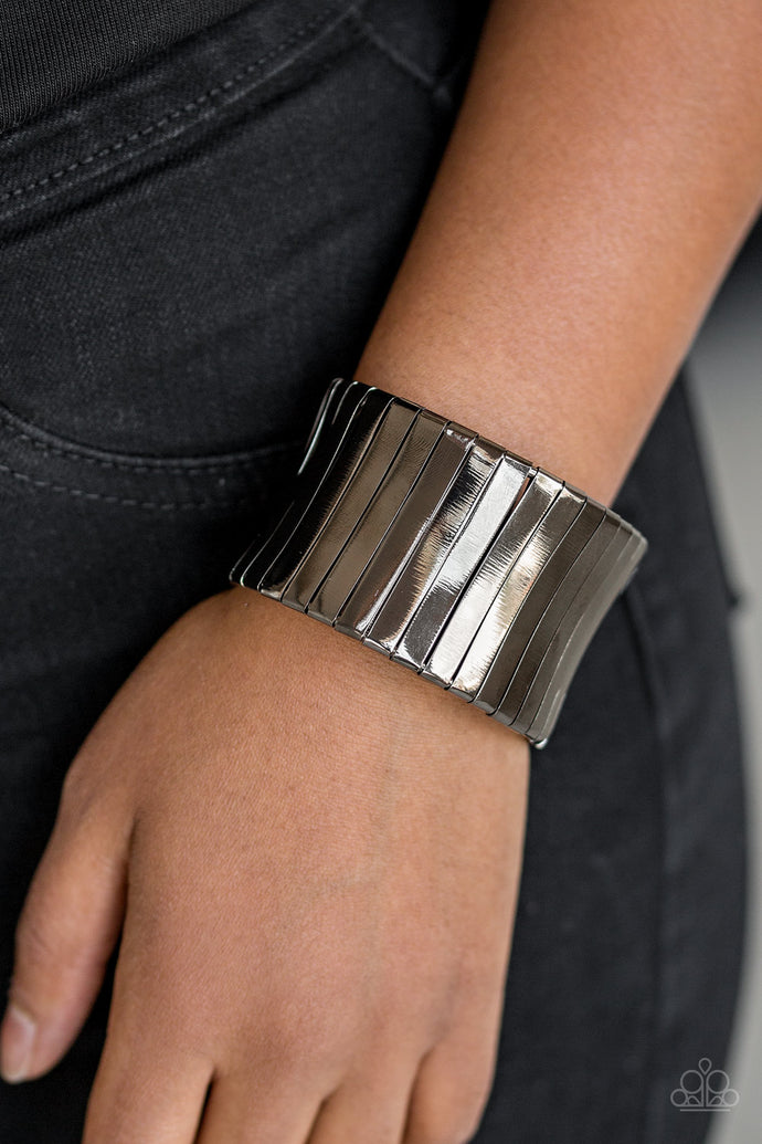 Flat gunmetal frames wrap around a gunmetal frame, creating a bold cuff around the wrist.  Sold as one individual bracelet.  Always nickel and lead free.