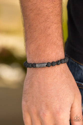 Infused with antiqued metallic accents, earthy black lava stones are threaded along a stretchy elastic band for a seasonal look.  Sold as one individual bracelet.  Always nickel and lead free.