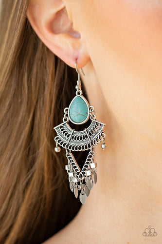A refreshing teardrop turquoise stone gives way to a stack of linked silver frames featuring bold tribal inspired patterns. Infused with glistening silver cube beads, a fringe of flat silver beads swing from the bottom for a flirtatiously wanderlust finish. Earring attaches to a standard fishhook fitting.  Sold as one pair of earrings.  Always nickel and lead free.  Life of the Party Exclusive February 2020