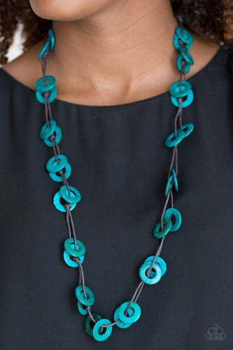 Shiny brown cording knots around refreshing blue wooden discs, creating a colorful display across the chest. Features a button loop closure.  Sold as one individual necklace. Includes one pair of matching earrings.  Always nickel and lead free.