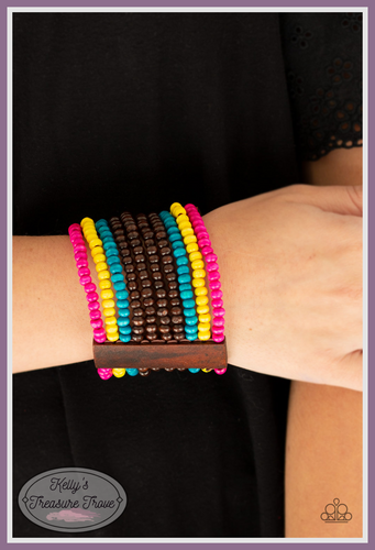 Infused with rectangular wooden beads, a collection of blue, brown, pink, and yellow wooden beads are threaded along stretchy bands for a summery flair.  Sold as one individual bracelet.  By Paparazzi Accessories. Always nickel and lead free.