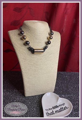 Heavy gunmetal chains give way to sections of bold gold and gunmetal beads. A glistening gold accent slides along joined rows of heavy gunmetal chains, creating a spunky industrial centerpiece below the collar. Features an adjustable clasp closure.
