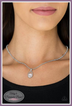 Load image into Gallery viewer, A dainty white pearl dots the bottom of a subtlety twisting silver teardrop frame, creating a classic pendant below the collar. Features an adjustable clasp closure.  Sold as one individual necklace. Includes one pair of matching earrings.  By Paparazzi Accessories.  Always nickel and lead free.