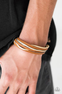 Strands of leather and twine layer across the wrist for an earthy urban look. Features an adjustable sliding knot closure.  Sold as one individual bracelet.  Always nickel and lead free.