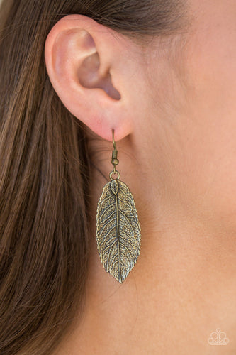 Featuring lifelike details, an antiqued brass leaf frame swings from the ear for a seasonal look. Earring attaches to a standard fishhook fitting.  Sold as one pair of earrings.  Always nickel and lead free.