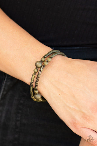 Sections of rounded brass wire mesh and antiqued brass beads are threaded along a coiled wire, creating a rustic infinity wrap style bracelet around the wrist.  Sold as one individual bracelet.  Always nickel and lead free.
