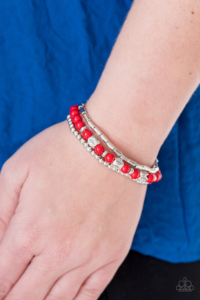Fiery red beads and silver beads featuring round and cylindrical shapes are threaded along elastic stretchy bands. Stamped in tree-like patterns, faceted silver beads are sprinkled between the colorful beads for a whimsical finish.  Sold as one set of three bracelets.  Always nickel and lead free.