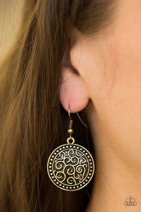 Brushed in an antiqued shimmer, a studded brass disc is embossed in vine-like filigree for a whimsical look. Earring attaches to a standard fishhook fitting.  Sold as one pair of earrings.  Always nickel and lead free.