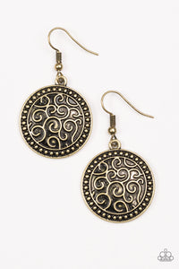 Brushed in an antiqued shimmer, a studded brass disc is embossed in vine-like filigree for a whimsical look.