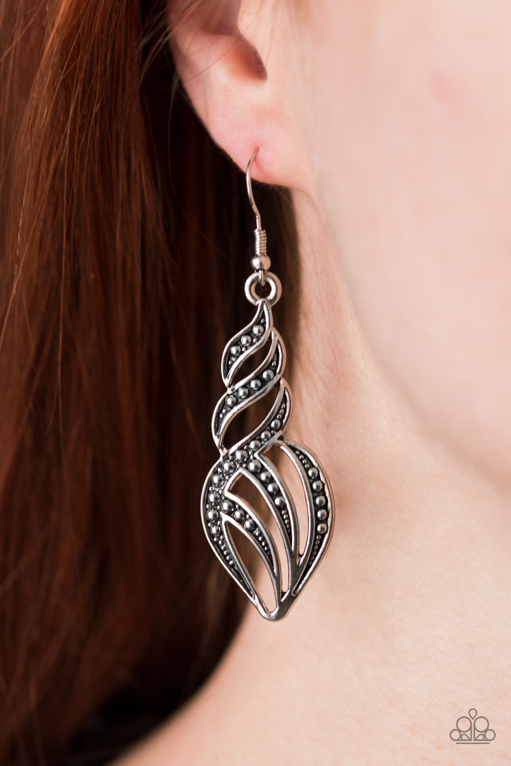 Dotted in glistening studs, antiqued silver ribbons swirl and swoop into a flame-like lure. Earring attaches to a standard fishhook fitting.  Sold as one pair of earrings.  Always nickel and lead free.