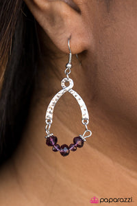 Delicately hammered with shimmery textures, a ribbon of silver swoops into a whimsical frame. Threaded along a silver wire, glittery crystal purple accents swing from the bottom of the frame for a sparkly finish. Earring attaches to a standard fishhook fitting.  Sold as one pair of earrings.  Always nickel and lead free.