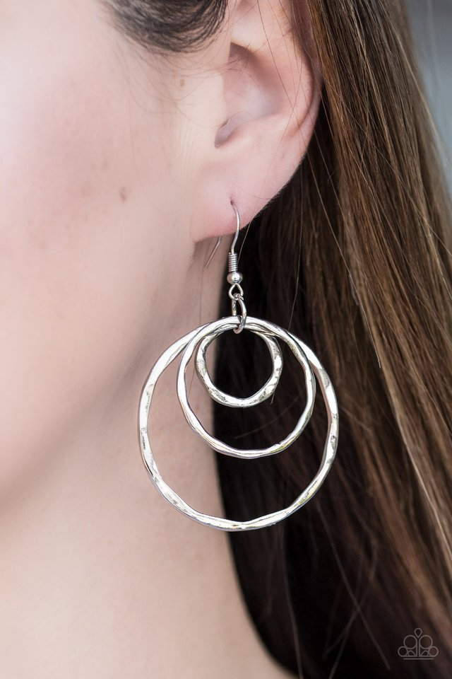 Delicately hammered in glistening shimmer, asymmetrical hoops cascade from the ear, creating a dizzying lure. Earring attaches to a standard fishhook fitting.  Sold as one pair of earrings.  Always nickel and lead free.