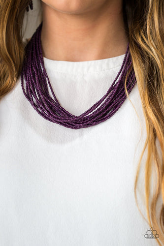 Infused with two large silver fittings, vivacious purple seed beads are threaded along countless strands, creating dramatic layers below the collar for a seasonal look. Features an adjustable clasp closure.  Sold as one individual necklace. Includes one pair of matching earrings.  Always nickel and lead free.