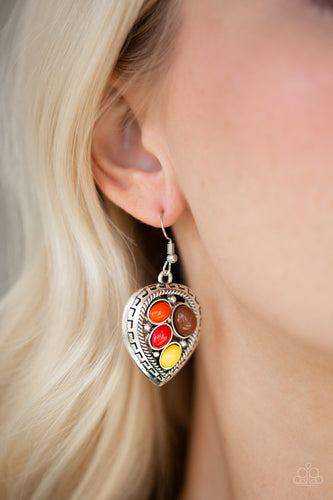 Varying in size, polished multicolored beads are sprinkled across the center of an asymmetrical heart-shaped frame for a whimsical look. Earring attaches to a standard fishhook fitting.  Sold as one pair of earrings.  Always nickel and lead free,