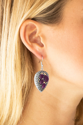 Varying in size, polished purple beads are sprinkled across the center of an asymmetrical heart-shaped frame for a whimsical look. Earring attaches to a standard fishhook fitting.  Sold as one pair of earrings.  Always nickel and lead free,