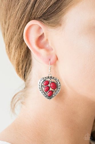 Varying in size, polished red beads are sprinkled across the center of an asymmetrical heart-shaped frame for a whimsical look. Earring attaches to a standard fishhook fitting.  Sold as one pair of earrings.  Always nickel and lead free.