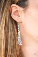 Load image into Gallery viewer, Hammered in endless shimmer, a triangular silver plate swings from the ear in a fierce fashion. Earring attaches to a standard fishhook fitting.  Sold as one pair of earrings.  Always nickel and lead free.