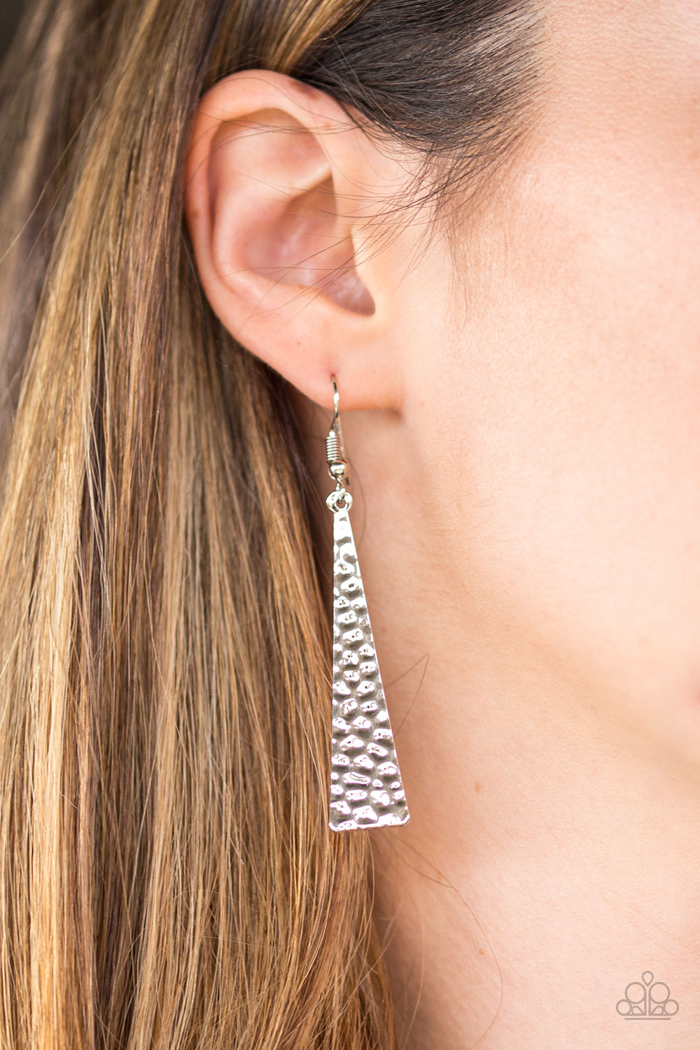 Hammered in endless shimmer, a triangular silver plate swings from the ear in a fierce fashion. Earring attaches to a standard fishhook fitting.  Sold as one pair of earrings.  Always nickel and lead free.