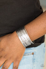 Load image into Gallery viewer,   Glistening silver wire wraps back and forth along an airy silver frame, creating a bold industrial cuff.  Sold as one individual bracelet.   Always nickel and lead free!