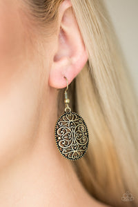 Glistening brass filigree climbs an oval brass frame, creating a whimsical lure. Earring attaches to a standard fishhook fitting.  Sold as one pair of earrings.  Always nickel and lead free.