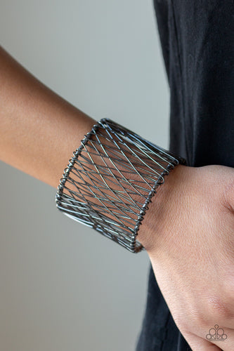 Wire after wire crisscrosses across the wrist, coalescing into an edgy cuff.  Sold as one individual bracelet.   Always nickel and lead free.