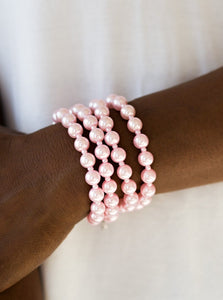 Rows of dainty and classic pink pearls are strung across the wrist for a timeless look. Features an adjustable clasp closure.  Sold as one individual bracelet.  Always nickel and lead free.