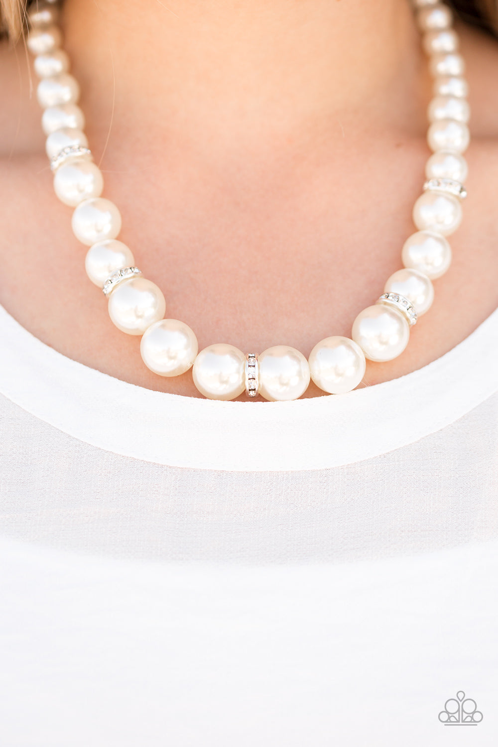 Gradually increasing in size, luminescent pearls trickle below the collar for a classic look. Encrusted in dazzling white rhinestones, glittery rings are sprinkled between the pearls for a timeless finish. Features an adjustable clasp closure.  Sold as one individual necklace. Includes one pair of matching earrings.  Always nickel and lead free.