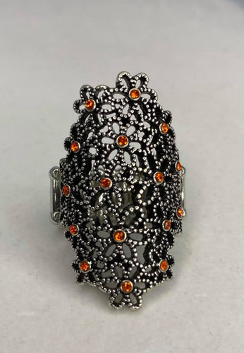 Dotted with dainty orange rhinestone centers, a bouquet of silver flowers blooms across the finger for a seasonally whimsical look. Features a stretchy band for a flexible fit.  Sold as one individual ring.  Always nickel and lead free.  Fashion Fix February 2021 Exclusive