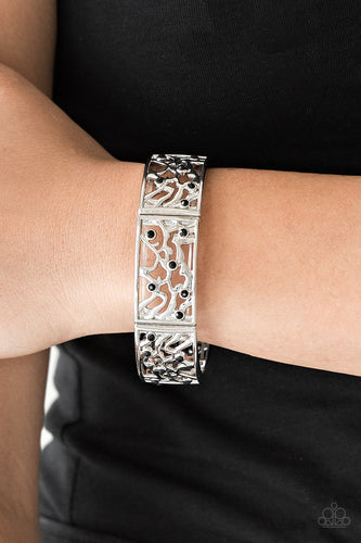Filled with vine-like filigree, shimmery silver frames are threaded along stretchy bands around the wrist for a whimsical look. Dainty black rhinestones are sprinkled along the ornate frames for a sparkling finish.  Sold as one individual bracelet.   Always nickel and lead free.